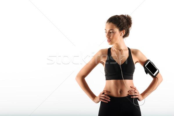 Mooie gekruld brunette fitness vrouw armen Stockfoto © deandrobot