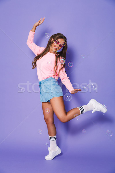Full length portrait of pretty young woman with two ponytails in Stock photo © deandrobot