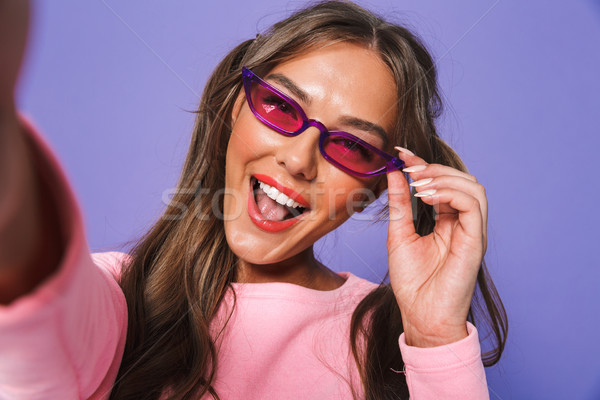 Portrait of a pretty young girl in sunglasses Stock photo © deandrobot