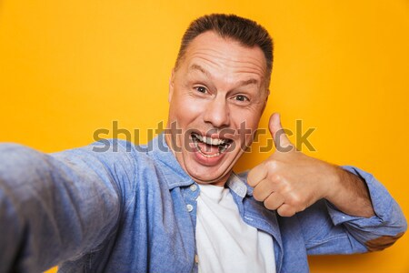 Portrait of an angry middle aged man threatens you Stock photo © deandrobot