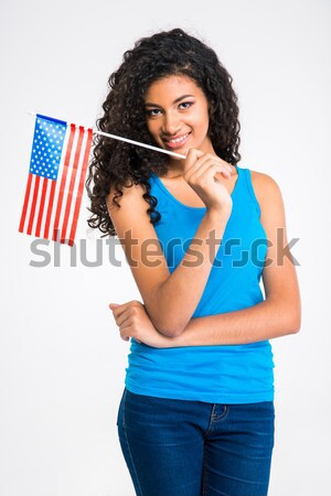 Cheerful asian man holding flag of USA over white background Stock photo © deandrobot