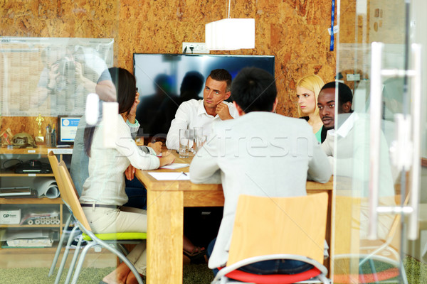 Multi-ethnic team during a meeting Stock photo © deandrobot