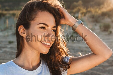 Closeup portrait of a young beautiful woman with closed eyes Stock photo © deandrobot