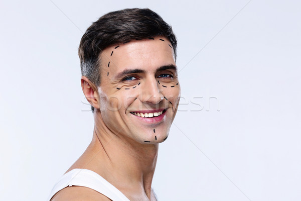 Happy man marked with lines for plastic surgery Stock photo © deandrobot