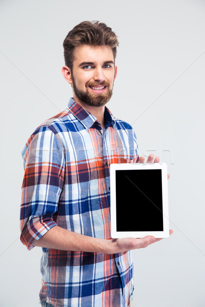 Stock photo: Man showing blank tablet computer screen