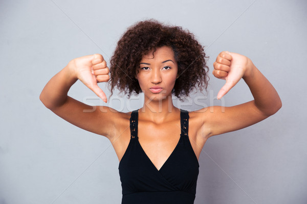 African woman showing thumb down  Stock photo © deandrobot