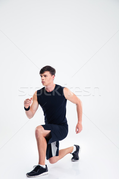 Full length portrait of a sports man warming up Stock photo © deandrobot