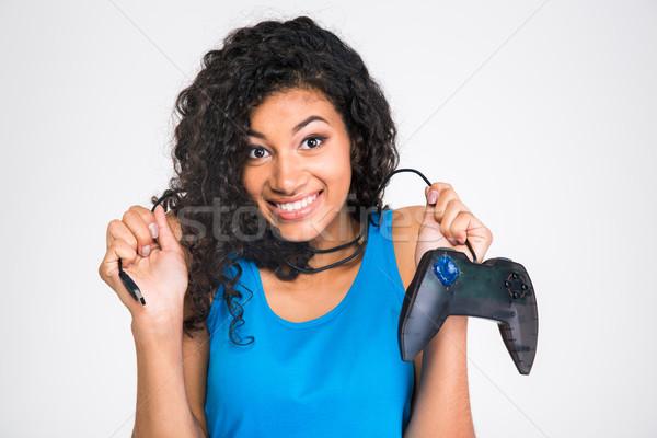 Mosolyog lány tart számítógépes játékok botkormány portré Stock fotó © deandrobot