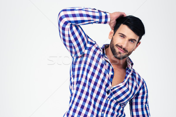 Portrait of a handsome macho looking at camera Stock photo © deandrobot