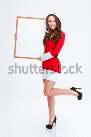 Smiling pretty woman standing with arms folded Stock photo © deandrobot