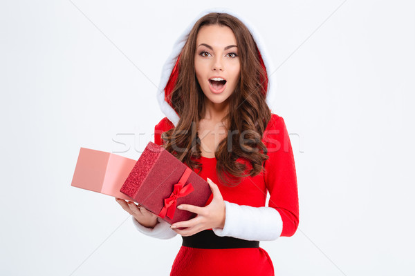 Wondered girl in red santa claus costume opened her present Stock photo © deandrobot