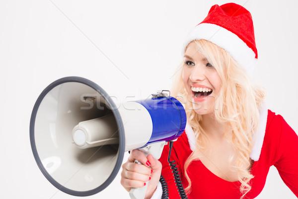 Funny amusing woman talking in speaker Stock photo © deandrobot