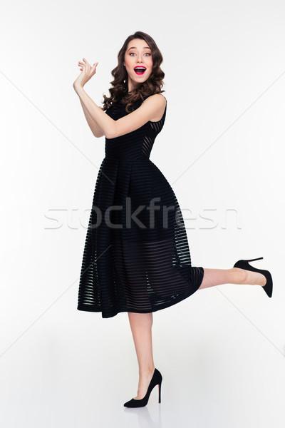 Bela mulher algo tanto mãos lado Foto stock © deandrobot