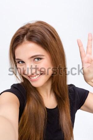 Pozitif gülümseyen kadın fotoğraf barış Stok fotoğraf © deandrobot