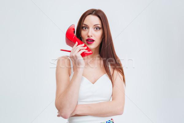 Güzel bir kadın kırmızı topuk genç yalıtılmış Stok fotoğraf © deandrobot