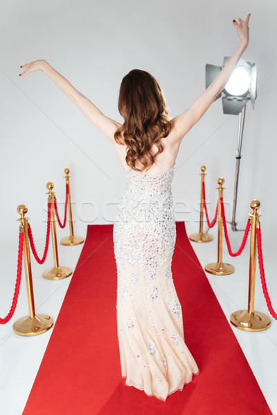 Woman walking on red carpet Stock photo © deandrobot