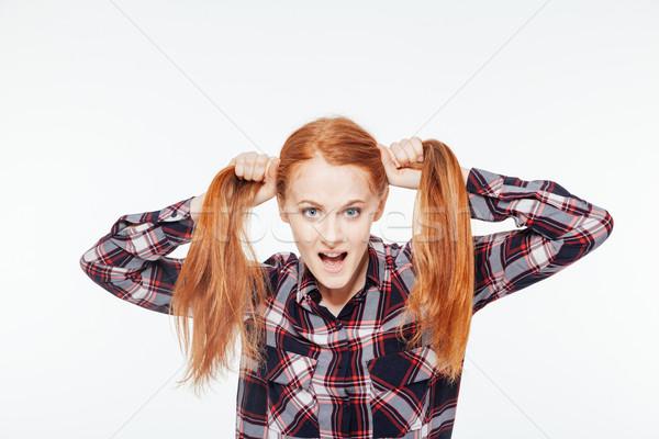 Vicces nő tart vörös hajú nő izolált fehér Stock fotó © deandrobot
