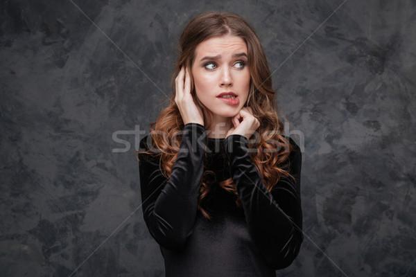 Ijedt zavart fiatal nő harap ajak portré Stock fotó © deandrobot