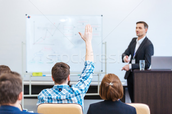 Teacher lecturing and tallking to students in univercity Stock photo © deandrobot