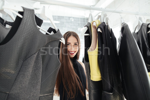 Woman shopping in a clothing store Stock photo © deandrobot