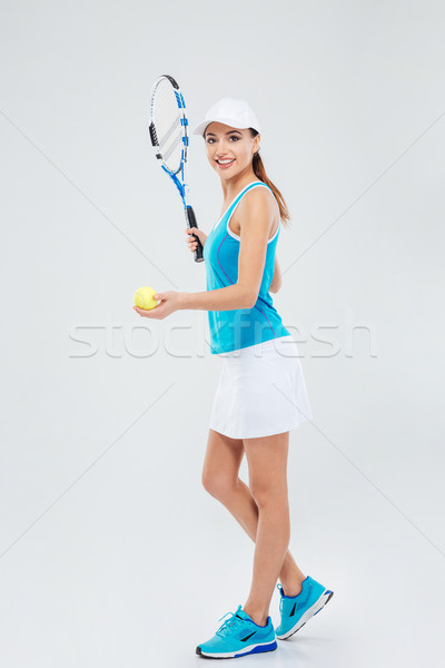 Full length portrait of a pretty woman playing in tennis Stock photo © deandrobot