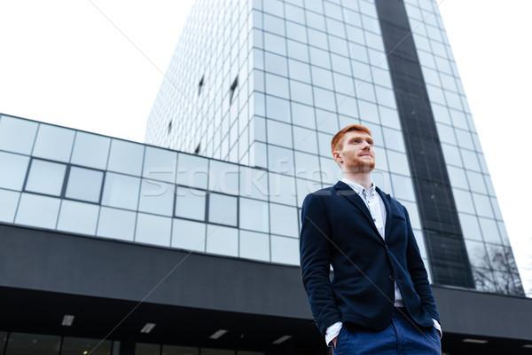Confident redhead businessman Stock photo © deandrobot
