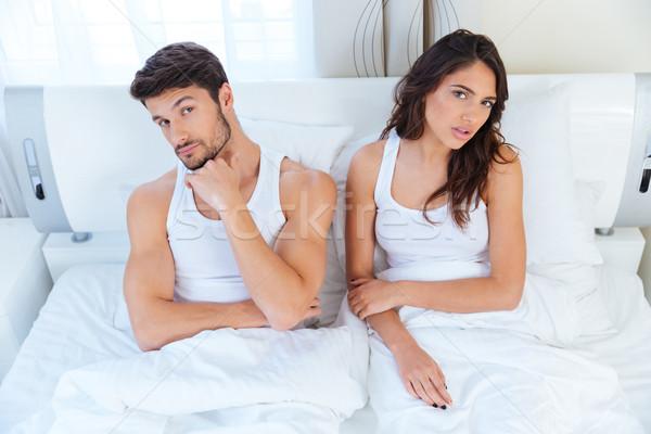 Infeliz casal não falante argumento cama Foto stock © deandrobot