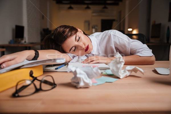 Weary business woman Stock photo © deandrobot