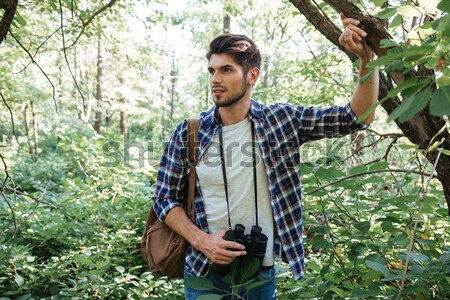 Man with backpack near the tree Stock photo © deandrobot