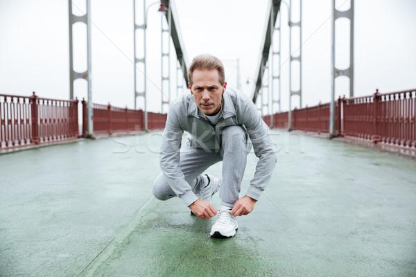 Runner prepare on bridge Stock photo © deandrobot