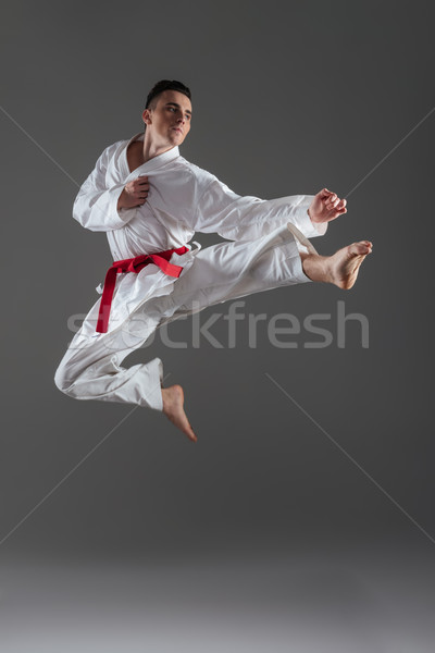 Vonzó fiatal sportoló gyakorlat karate izolált Stock fotó © deandrobot