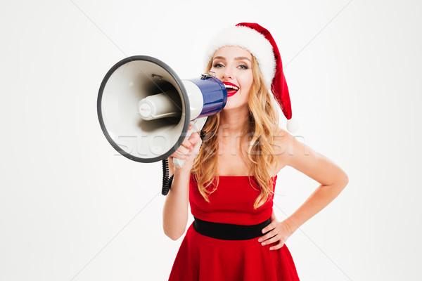 Boldog fiatal nő mikulás jelmez kiált hangfal Stock fotó © deandrobot