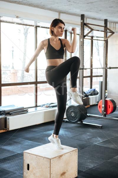 Kadın atlet atlama spor salonu ince Stok fotoğraf © deandrobot