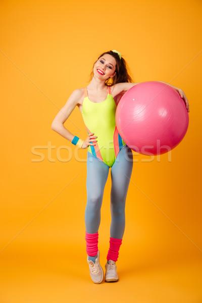 şaşırtıcı genç spor kadın poz sarı Stok fotoğraf © deandrobot