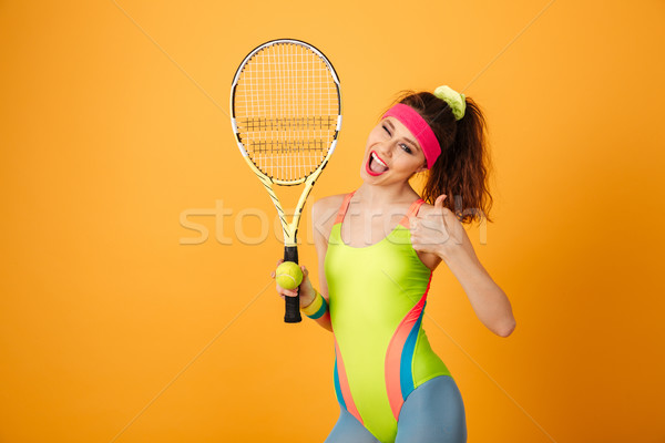 Happy young woman athlete with tennis racket showing thumbs up Stock photo © deandrobot