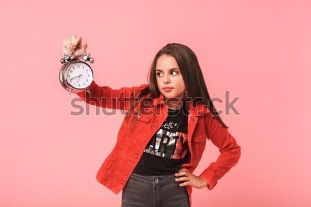 Assustado mulher jovem despertador olhando câmera Foto stock © deandrobot