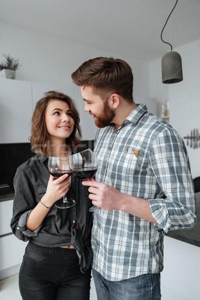 Loving happy couple drinking alcohol. Stock photo © deandrobot