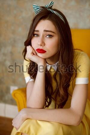 érzéki gyönyörű tő felfelé lány citromsárga Stock fotó © deandrobot