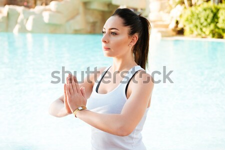 Young fitness lady make yoga exercises Stock photo © deandrobot