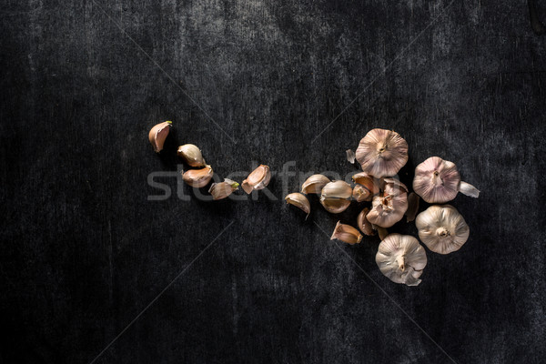 Photo of a garlic over dark background Stock photo © deandrobot