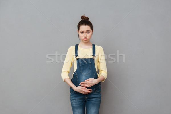 Sad pregnant woman Stock photo © deandrobot