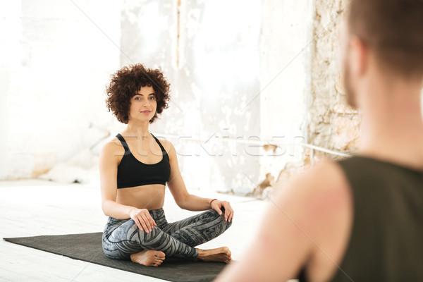 Sorridente mulher jovem ioga classe masculino instrutor Foto stock © deandrobot
