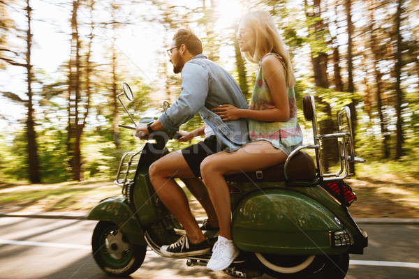 Bearded man on scooter with girlfriend outdoors Stock photo © deandrobot