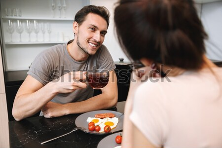 Young woman smiling to her brother Stock photo © deandrobot