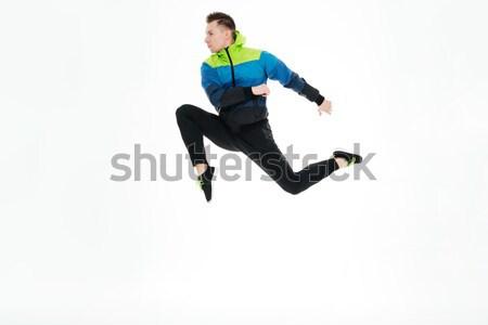 Erős sportoló ugrik izolált fehér kép Stock fotó © deandrobot