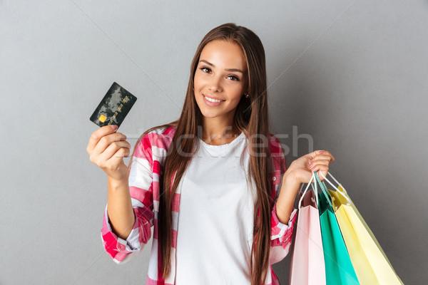 若い女の子 ショッピングバッグ クレジットカード 見える カム ストックフォト © deandrobot