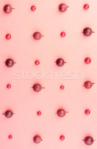 Keverék bogyók izolált rózsaszín asztal felső Stock fotó © deandrobot