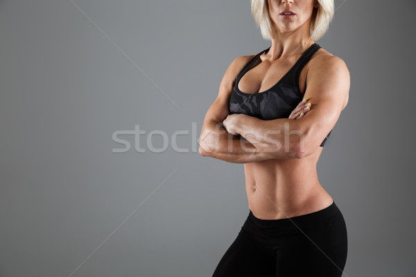 Cropped image of a muscular adult sportswoman Stock photo © deandrobot