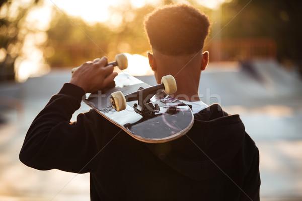 вид сзади мужчины подростку парень скейтборде Сток-фото © deandrobot