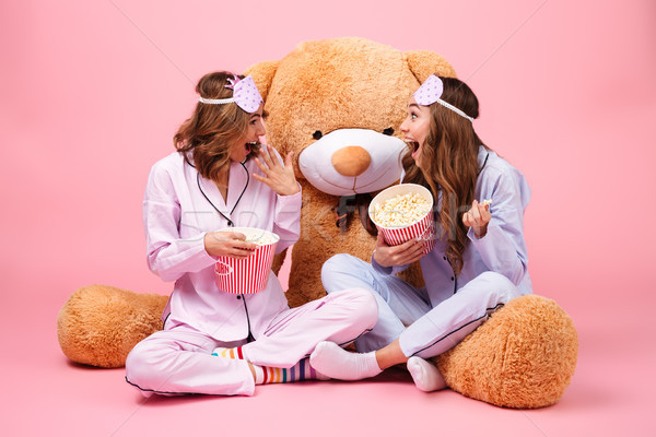 Two happy pretty girls dressed in pajamas Stock photo © deandrobot